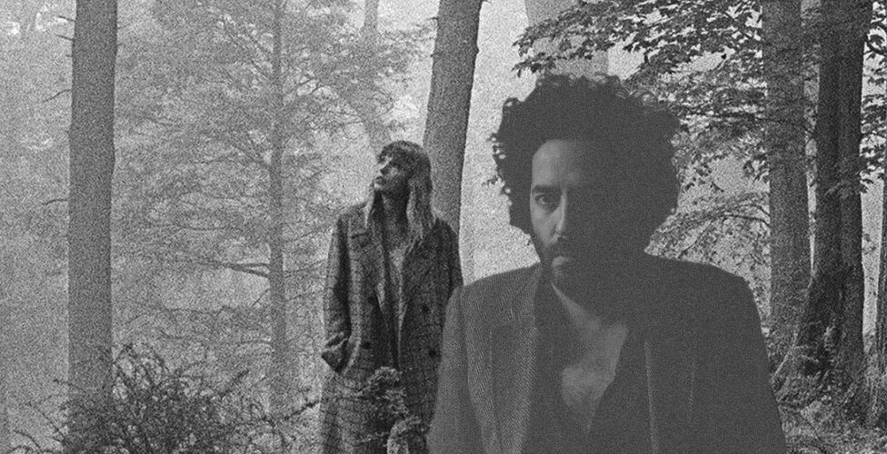 Taylor Swift and Dan Bejar having fun in the woods